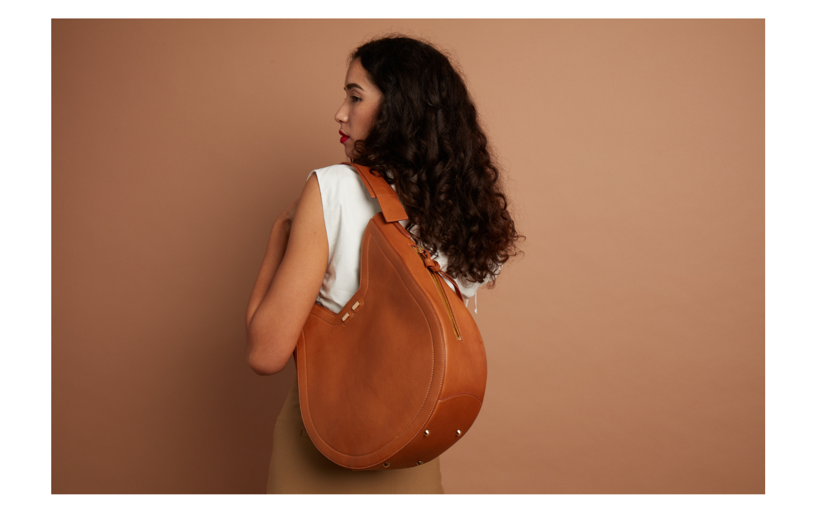 The Henry James Hobo is the chicest bag in town. This unique shape will fit all your everyday essentials. The swivel strap is made for ease and comfort and the side zipper is a secret pocket for easy access. There is a back pocket to slip your credit card