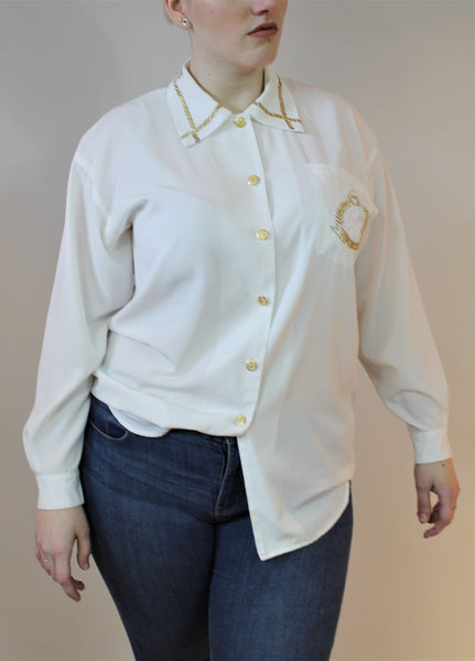 White button shirt with gold crest