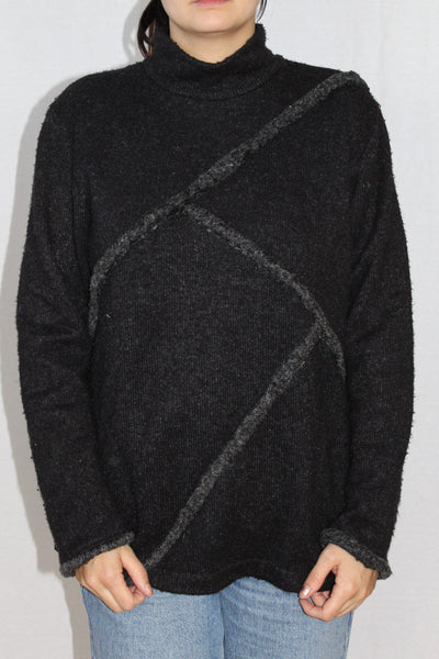 Patchwork black wool sweater