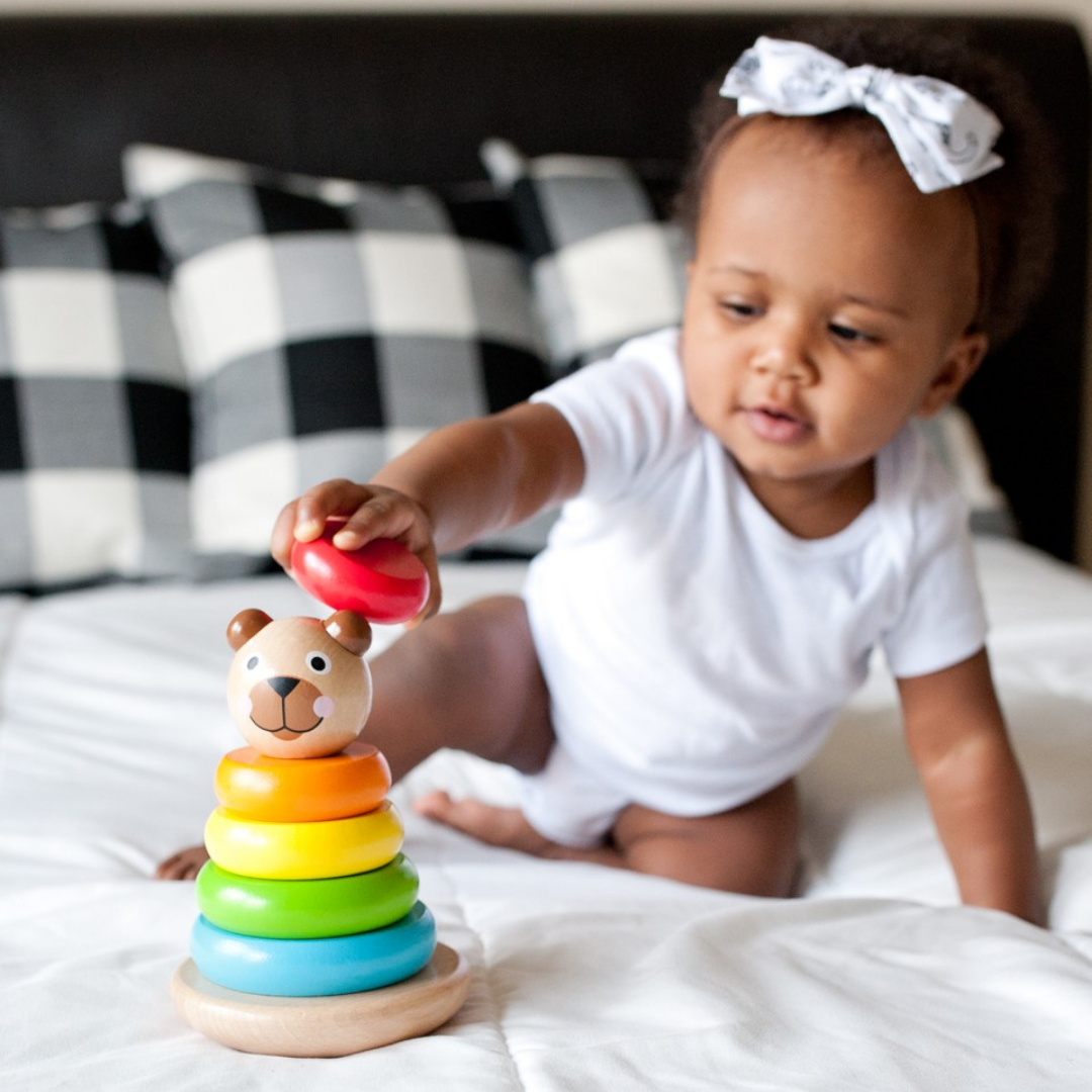 Little girl playing with Brilliant Bear Magnetic Stack Up