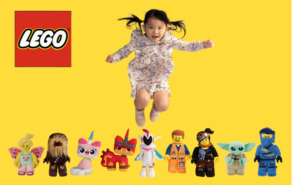 Girl jumping over LEGO minifigure plush characters.