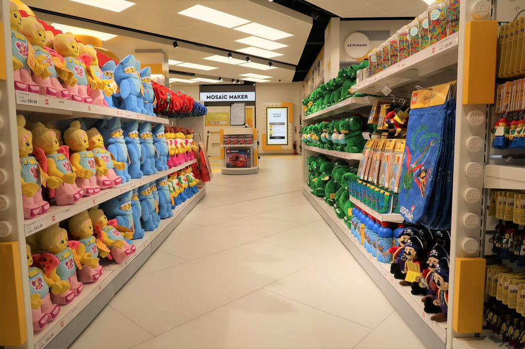 In store aisle view of new LEGO minifigures in Windsor, UK store.