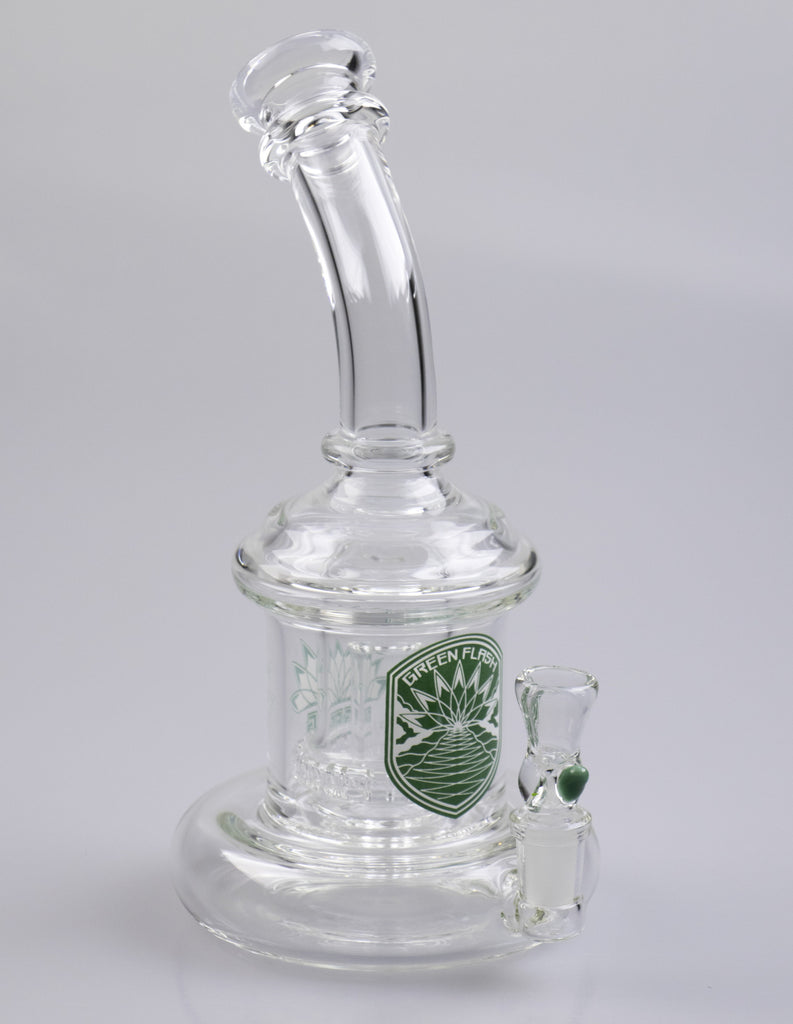 Green Flash Glass shower head bubbler is a versatile piece for use with flowers and concentrates. A nice wide base and low center of gravity means your dog won't knock this puppy off the table.