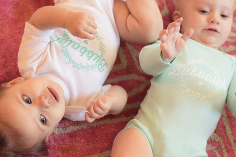 Bubbalah White Short-Sleeve Onesie with Mint Green ink