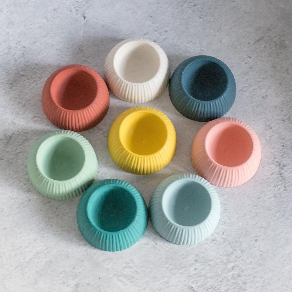multicoloured egg cups made from jesmonite using vacuum formed molds