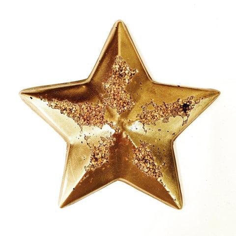 a gold chocolate star made with a FormBox mold