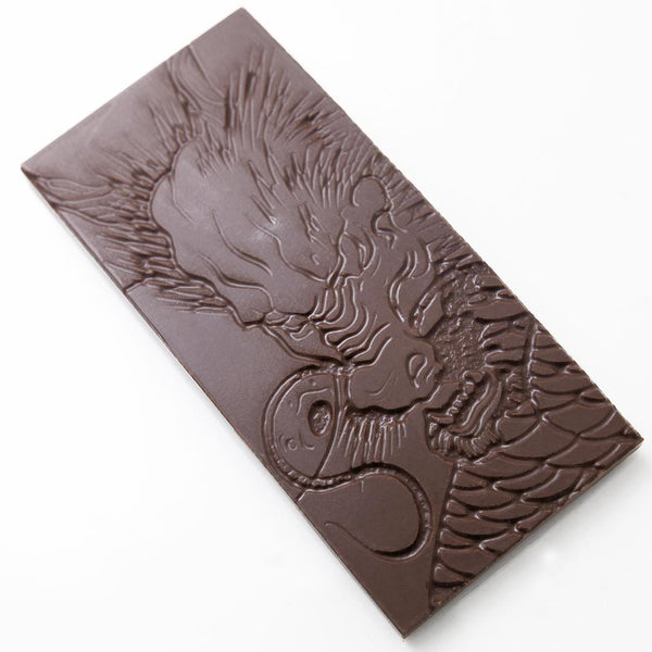 Custom dragon chocolate bar made by vacuum forming over laser-etched wood