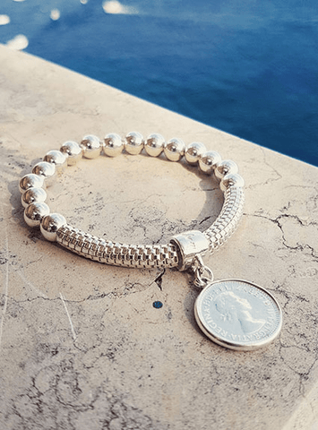 Bracelet with coin charm