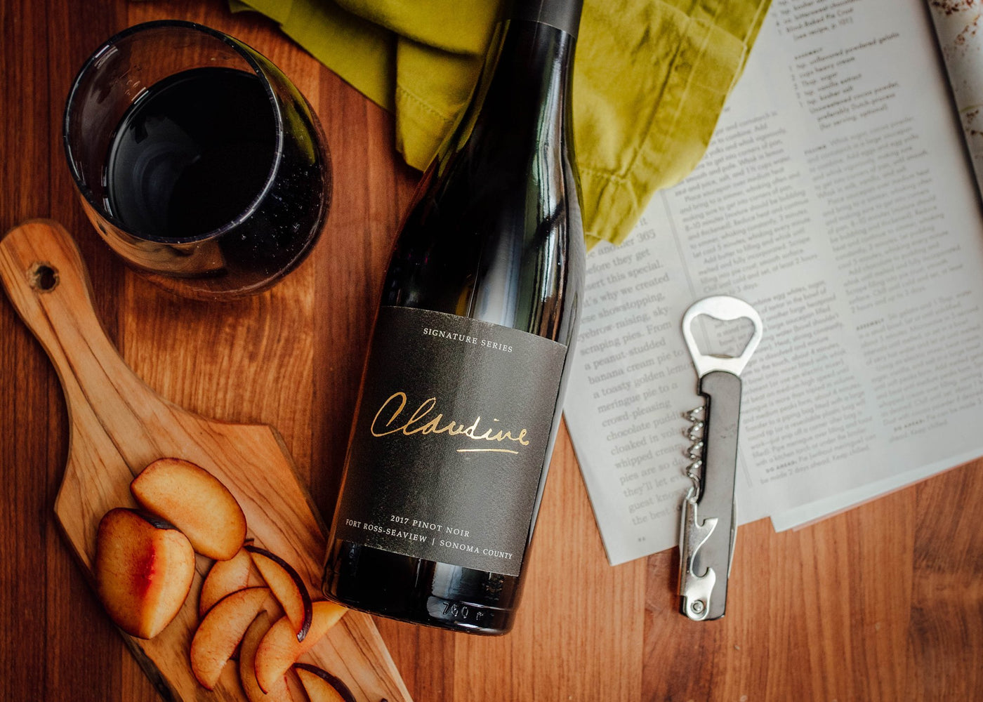 flat lay of Claudine signature wine
