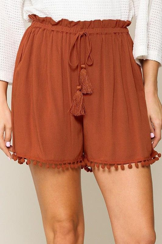 Shake Your Pom-Poms Tassel Shorts in Spice