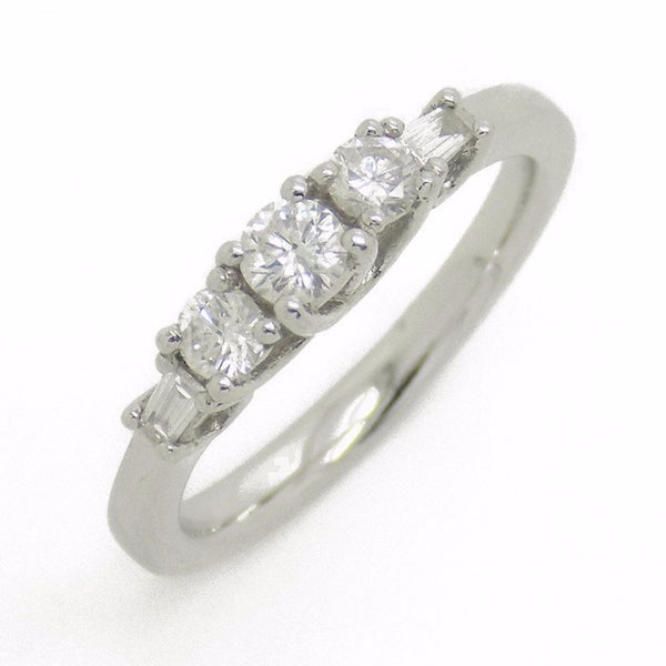 Platinum Three Round Stone Diamond Ring with Tapered Baguette Cut Diamonds