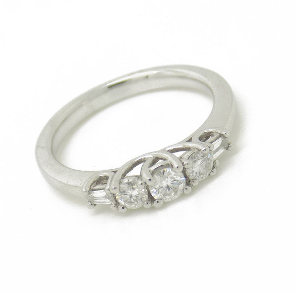 Platinum Three Round Stone Diamond Ring with Tapered Baguette Cut Diamonds Stone Detail
