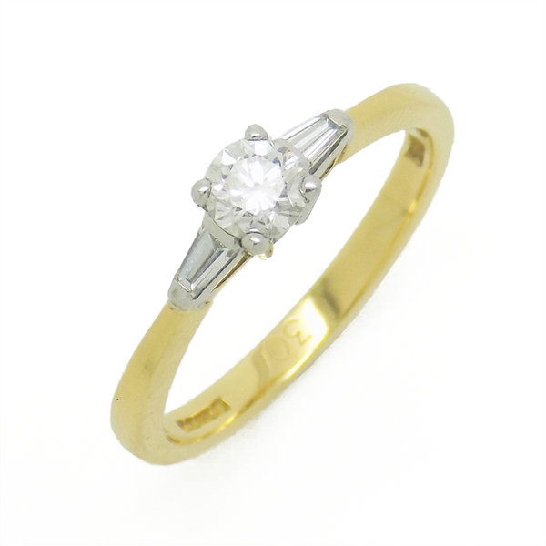 18ct Yellow Gold Single Round Diamond Ring with Tapered Baguette Cut Diamond Shoulders
