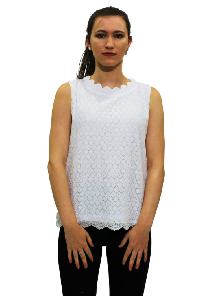 White sleeveless lace top with curved neckline
