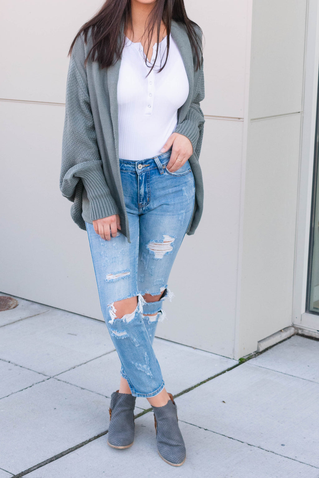 Sage Green Batwing cardigan, worn with distressed cropped denim jeans - Boutique Bleu