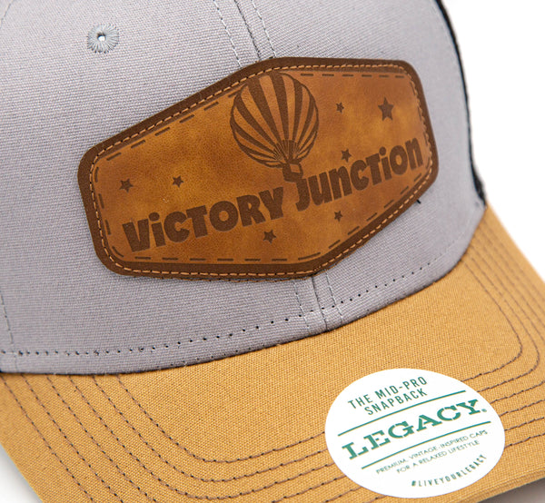 Legacy Trucker Hat: The Mid-Pro Snapback