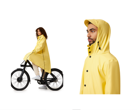 a male and a female model wearing the new maium rain coat in sunshine yellow made from recycled bottles
