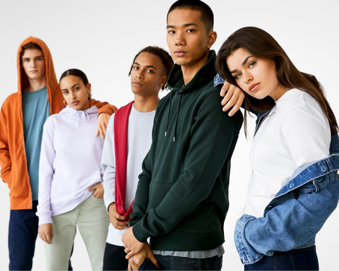 Five young adults posing for a group picture wearing colorful sweaters from colorful standards