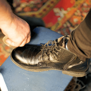 Cleaning and spot removers for shoe care tasks