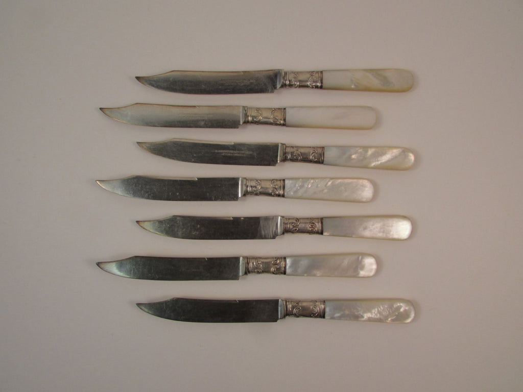 Vintage Landers Frary and Clark Aetna Works Fruit Knives Set of Seven Mother of Pearl Handles Sterling Bolsters and Silver Plate Blades
