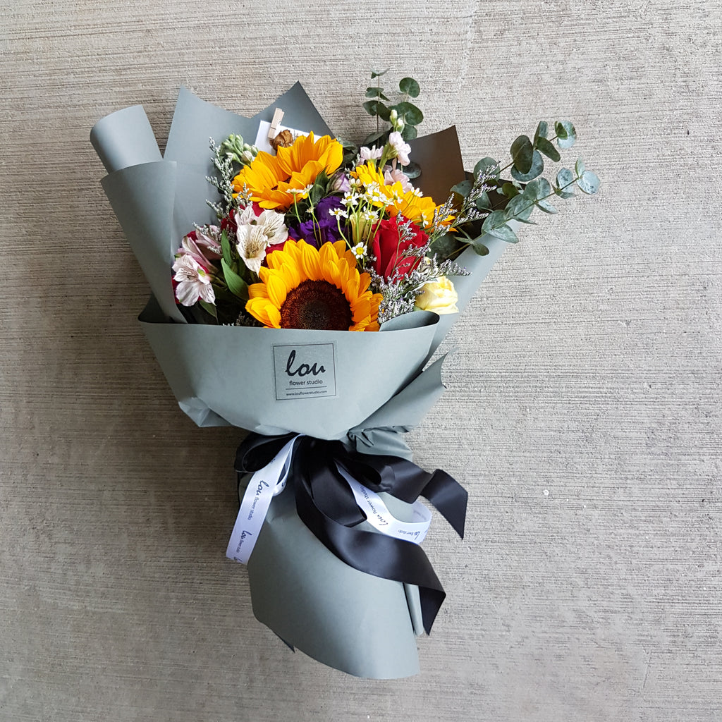 Sunflower bouquet with assortment of gardeny blooms. Free delivery.