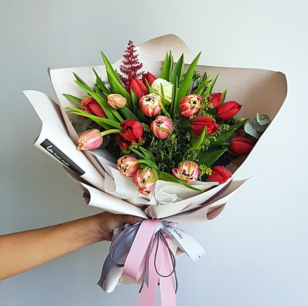 Standard sized Sweet Tulips. 20 tulips wrapped in our signature korean wrap. Free delivery
