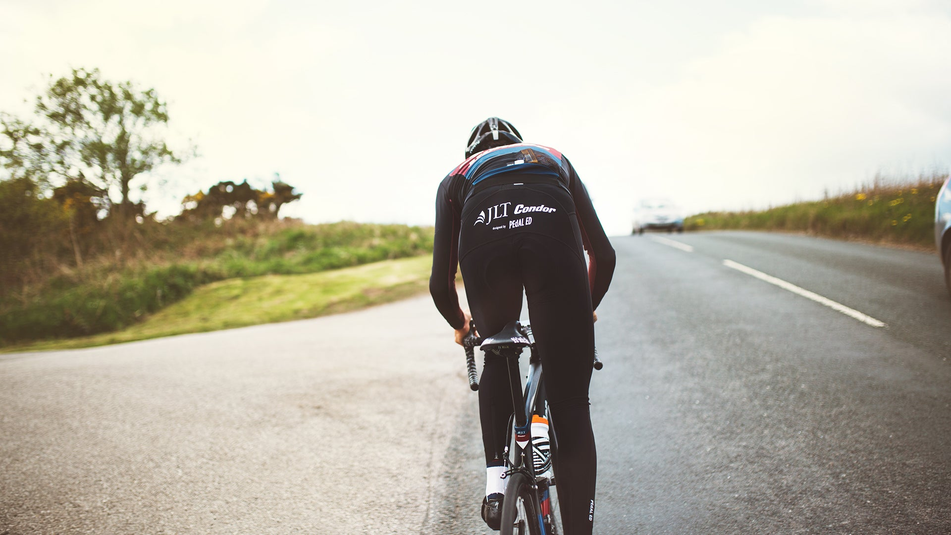 JLT Condor rider out of the saddle