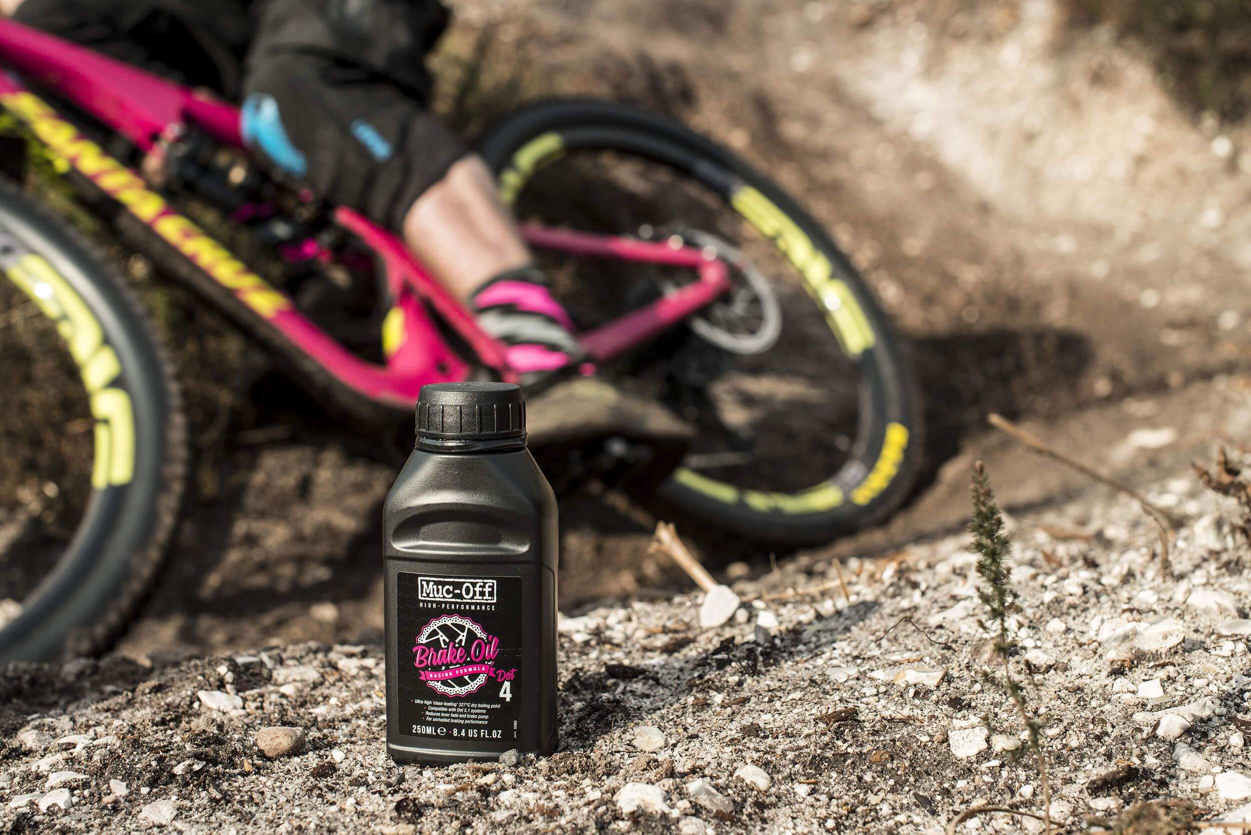 bike oil bottle with santa cruz MTB behind