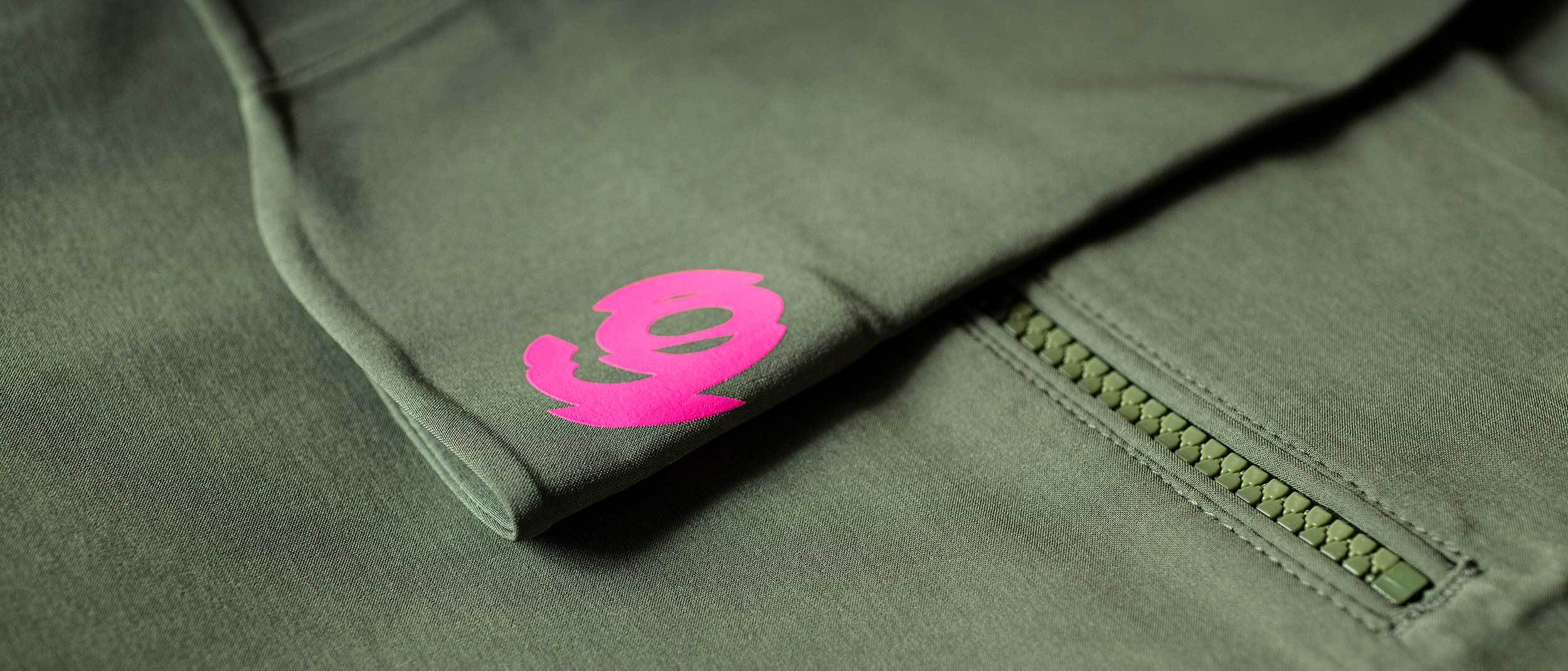 Pink 94 logo detail next to zip pocket