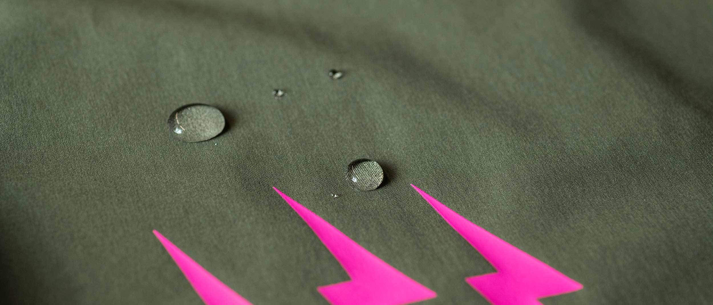Water droplets near pink bolt logo