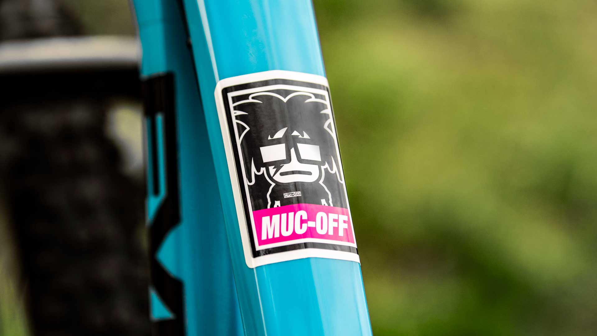 Cartoon Muc-off branded stickers on bike frame