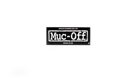 Small muc-off sticker on white background