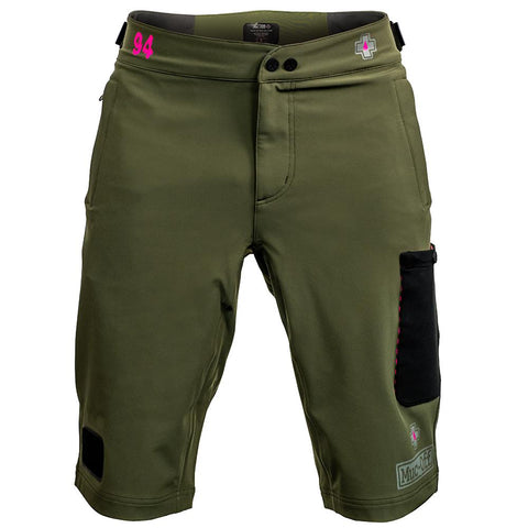 Front view of Polartec green technical riders shorts on a white background