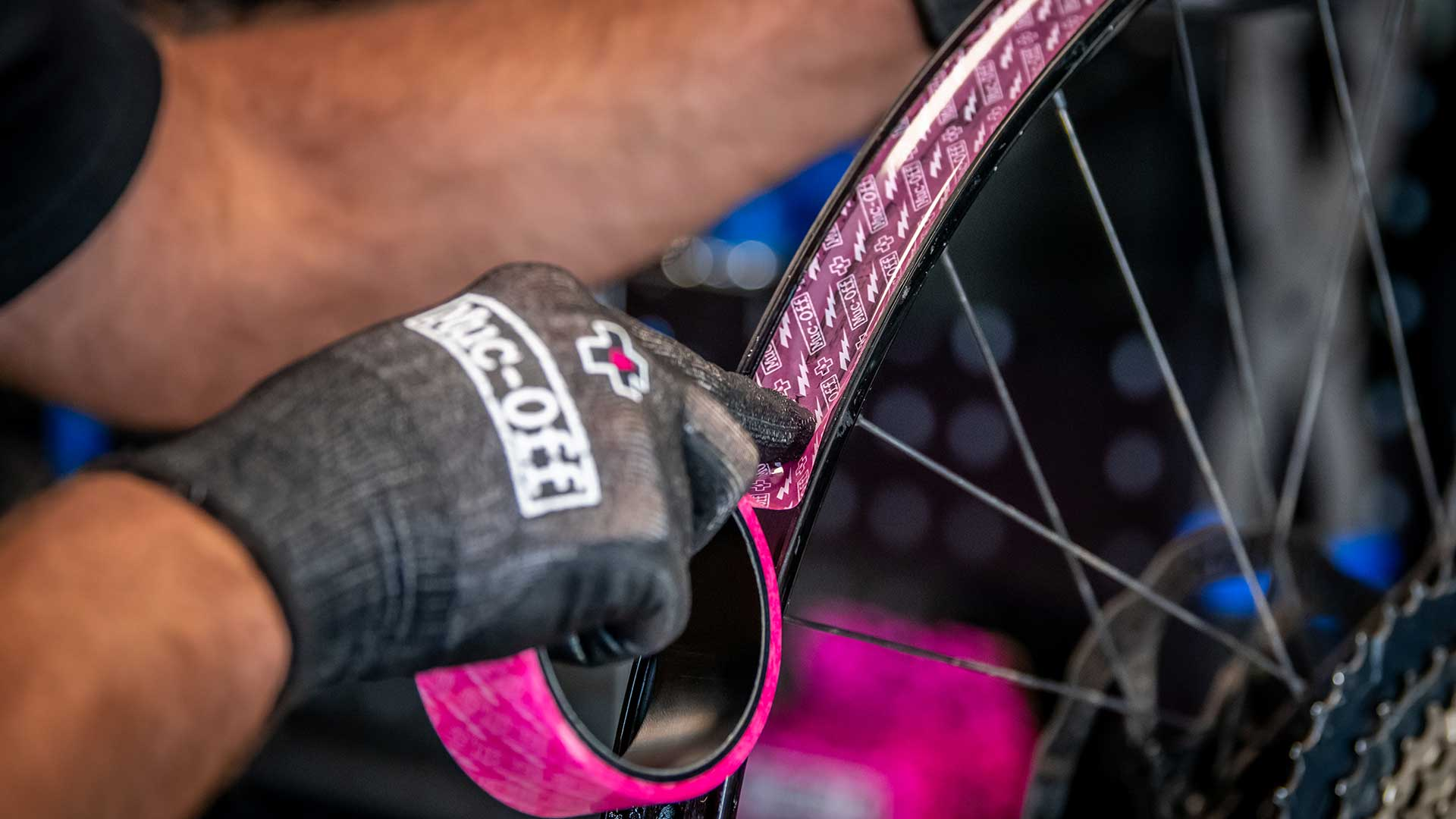 Applying Muc-Off tubeless tape to a bike rim