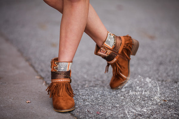 chains and fringe booties