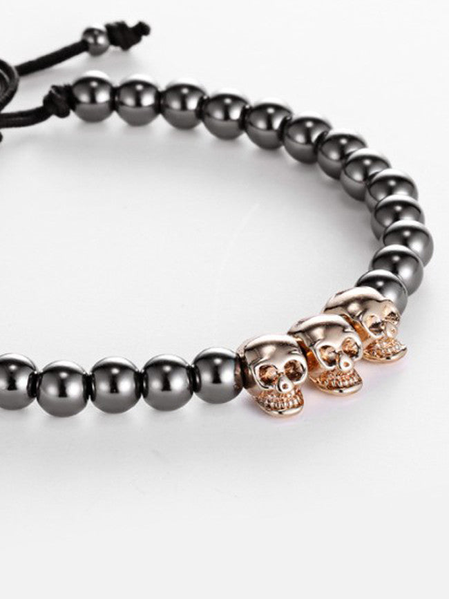 18K Gold ION Plated 3 Skull beads with 6mm Gun Black Steel Beads Bracelet