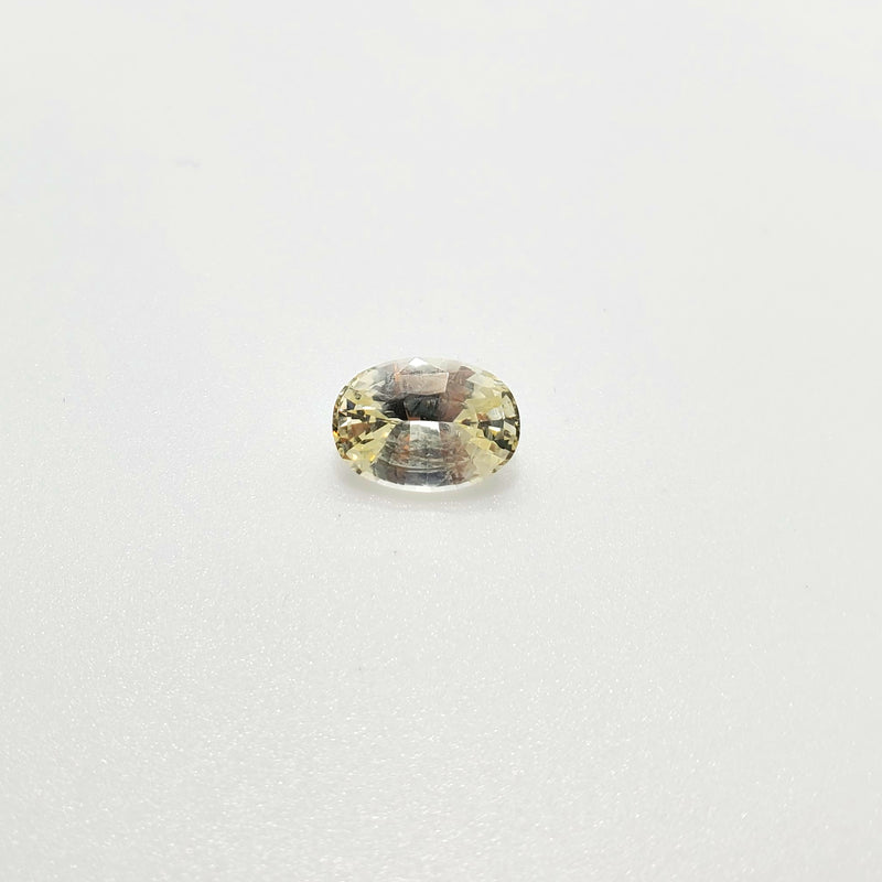 Fancy Color Faint Yellow Sapphire Oval Cut 1.81 ct - Gemorex International Inc