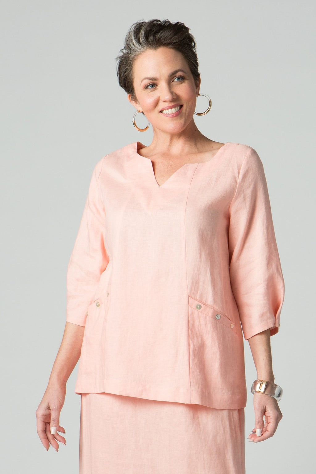 "29"" V Neck tunic with two front pockets and button sleeve detail"