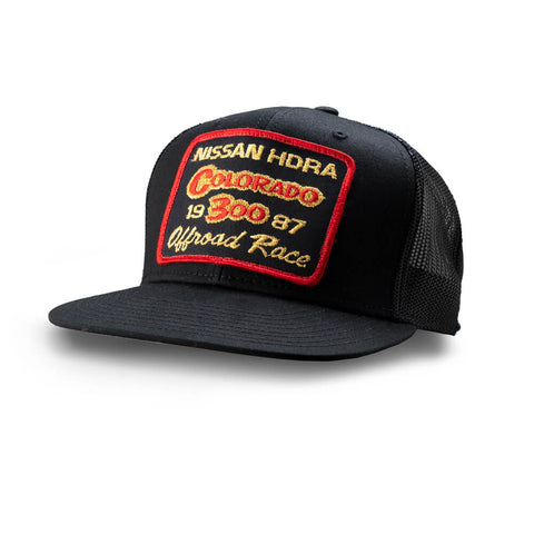 Dirt Co. 1987 Nissan HDRA Colorado 300 Offroad Race Vintage Patch Hat (Black/ Black Mesh)
