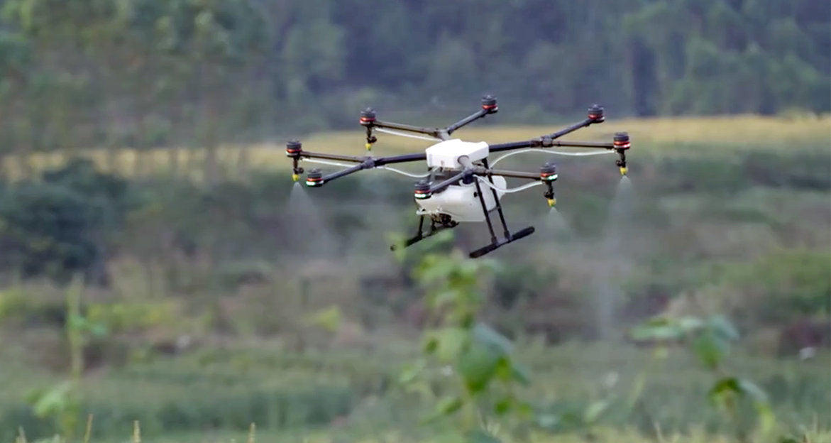 DJI Agras Drone spraying a crop