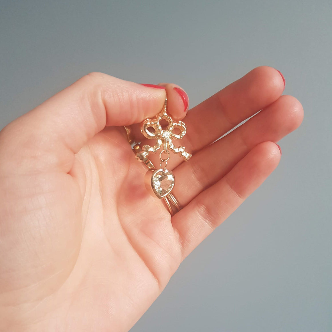Solid gold bow and green amethyst heart pendant ella green irish jewellery designer
