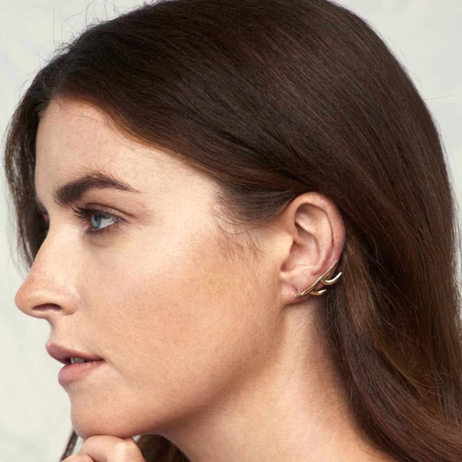 Metamorphosis Irish jewellery designer Ella Green yellow gold dream ear climber insect jewelry