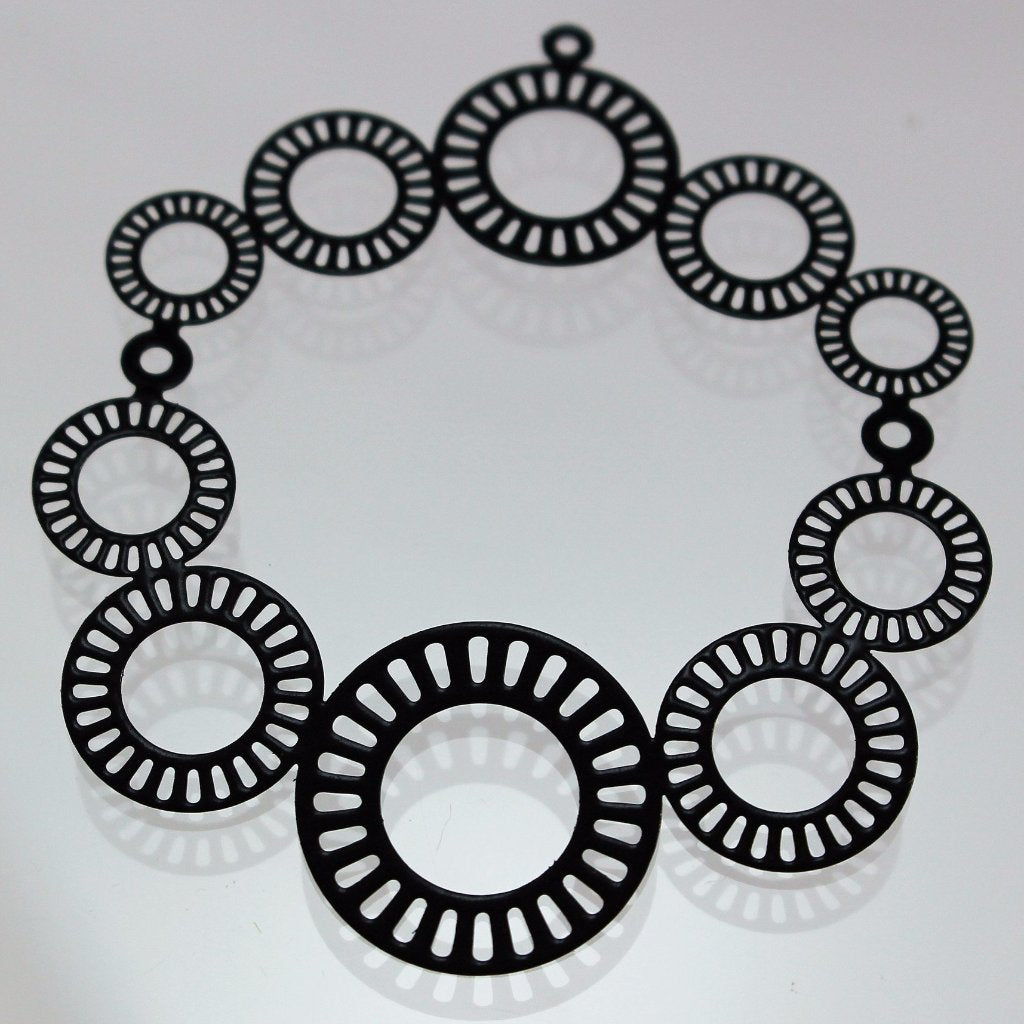 Components, Black Die Cut Pendant/Connectors. Sku B33037A - Azillion Beads