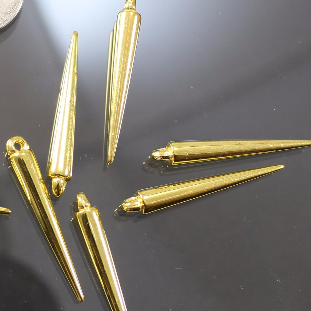 Charms, Gold Plated Resin Spikes. Sku B42012A - Azillion Beads