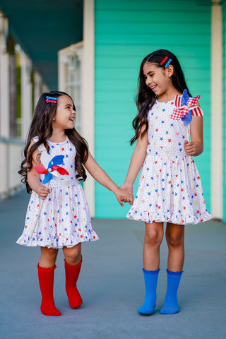 sisters in 4th of July dresses