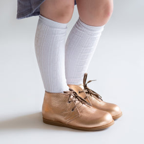 White cable knit knee high socks for babies, toddlers and girls.