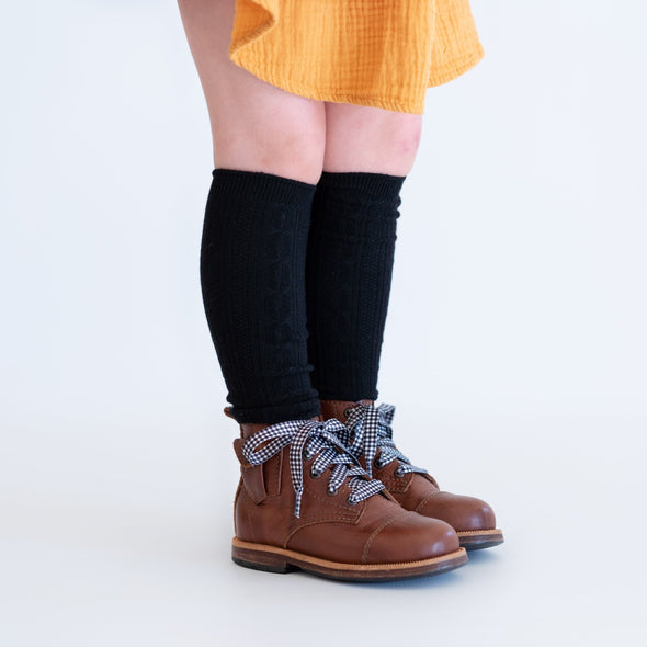Black knee high socks on little girl.