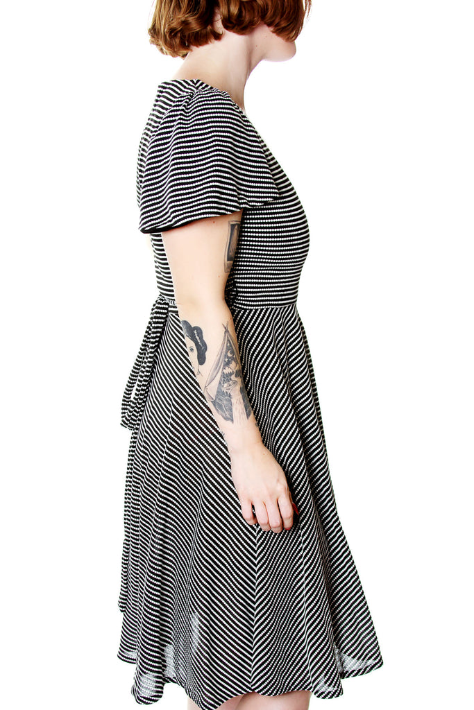Barbara Flutter sleeve wrap dress by Jessica Louise