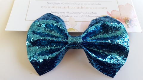 Turquoise glitter statement bow