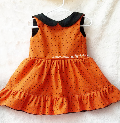 Violette Pinafore in Black and orange polka dots